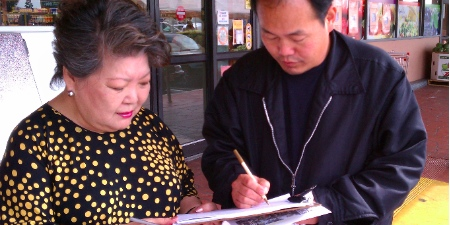 Collecting petition signatures outside a grocery store